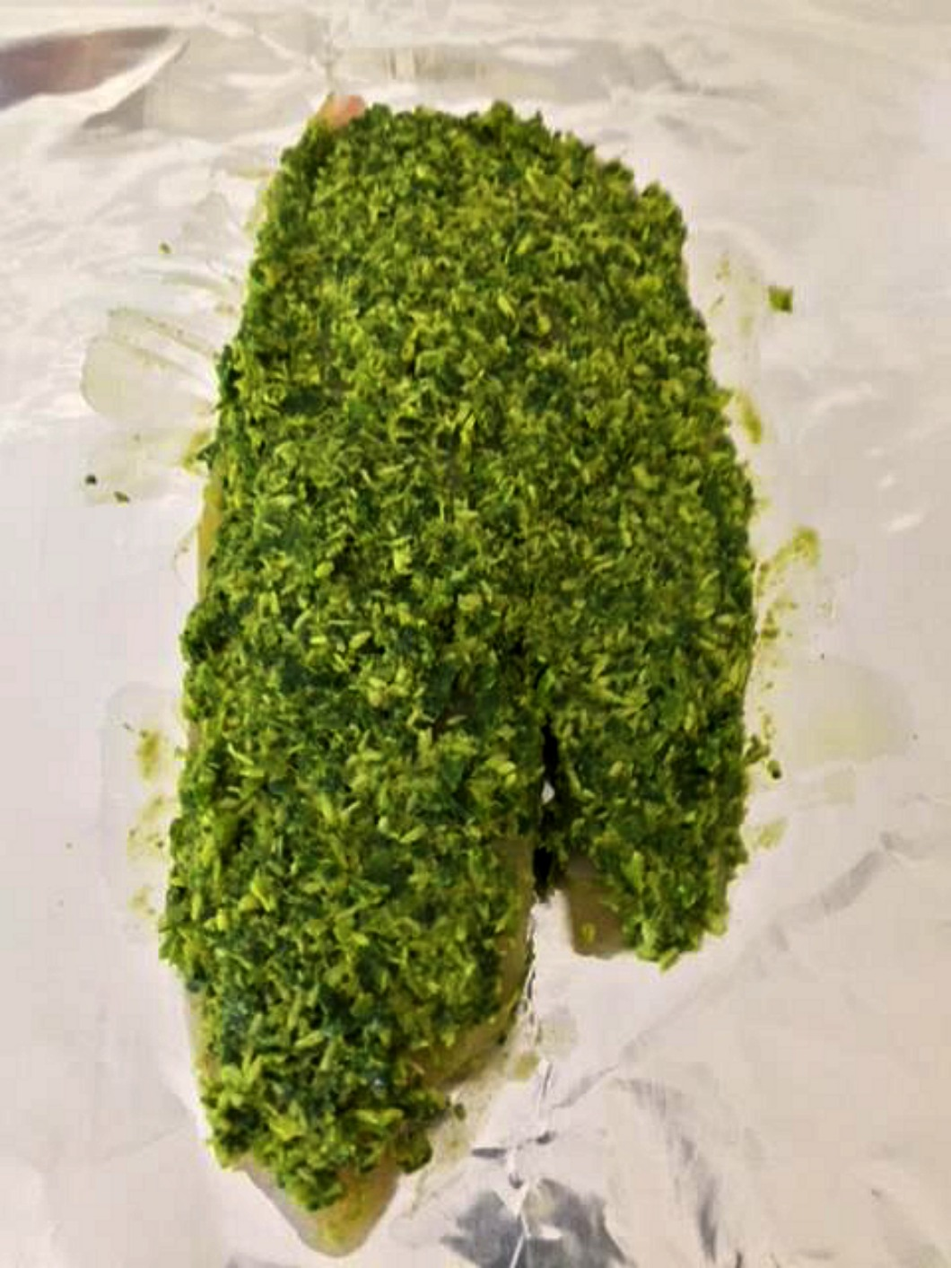 fresh pureed chutney encrusted on raw tilapia