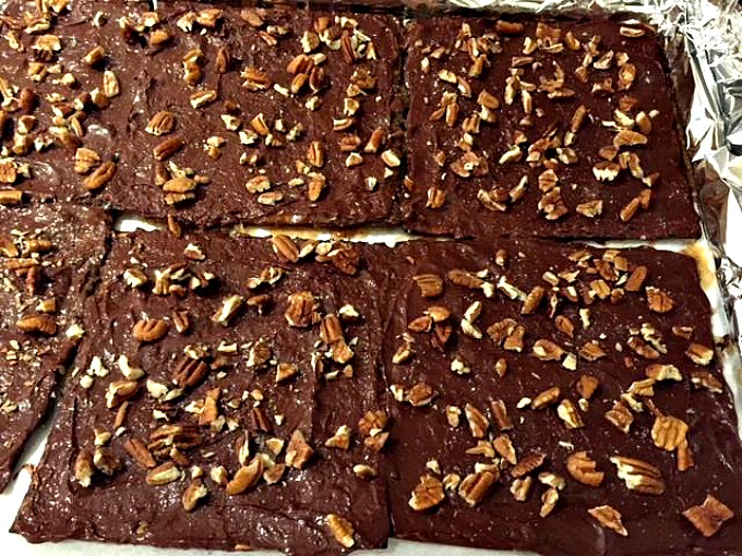 Matzo with toffee, melted chocolate chips, pecans and sea salt prior to pacing in refrigerator