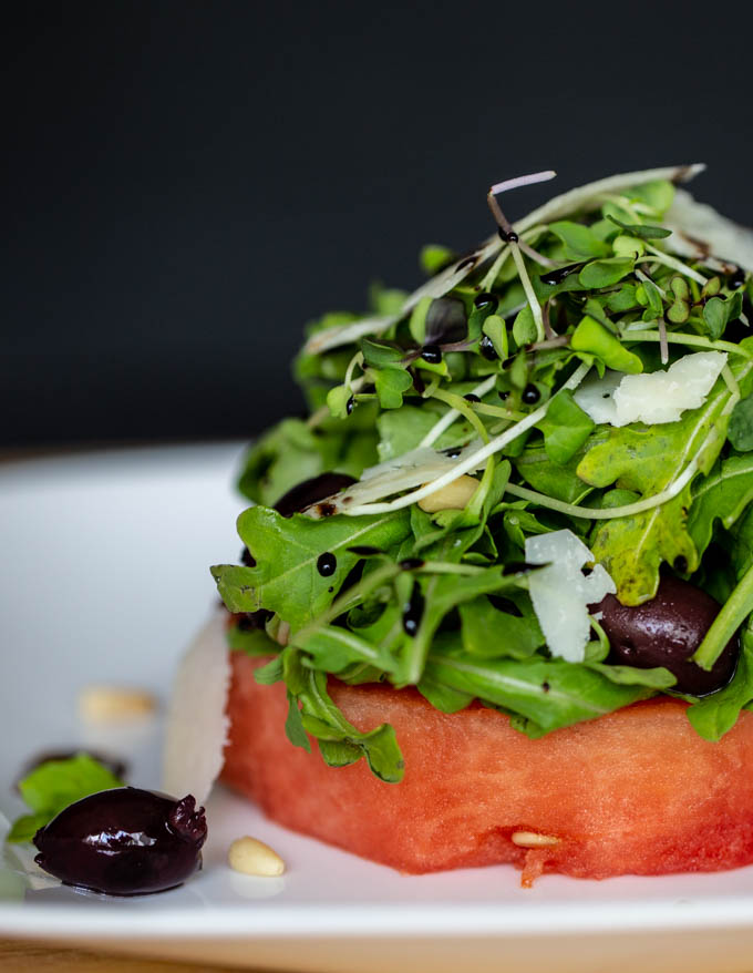 Watermelon Salad with Peccorino, Kalamata Olives, Pine Nuts and Balsamic Reduction
