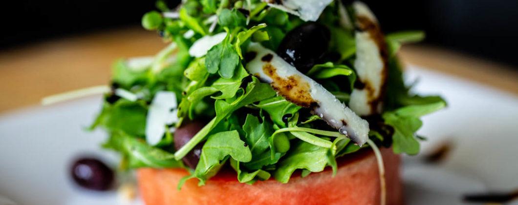 Watermelon Salad with Arugula, Pine Nuts, Peccorino Cheese, Kalamata Olives, & Balsamic Reduction