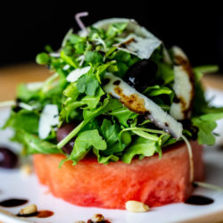 Watermelon Salad with Arugula, Pine Nuts, Peccorino Cheese, Kalamata Olives, & Balsamic Reduction