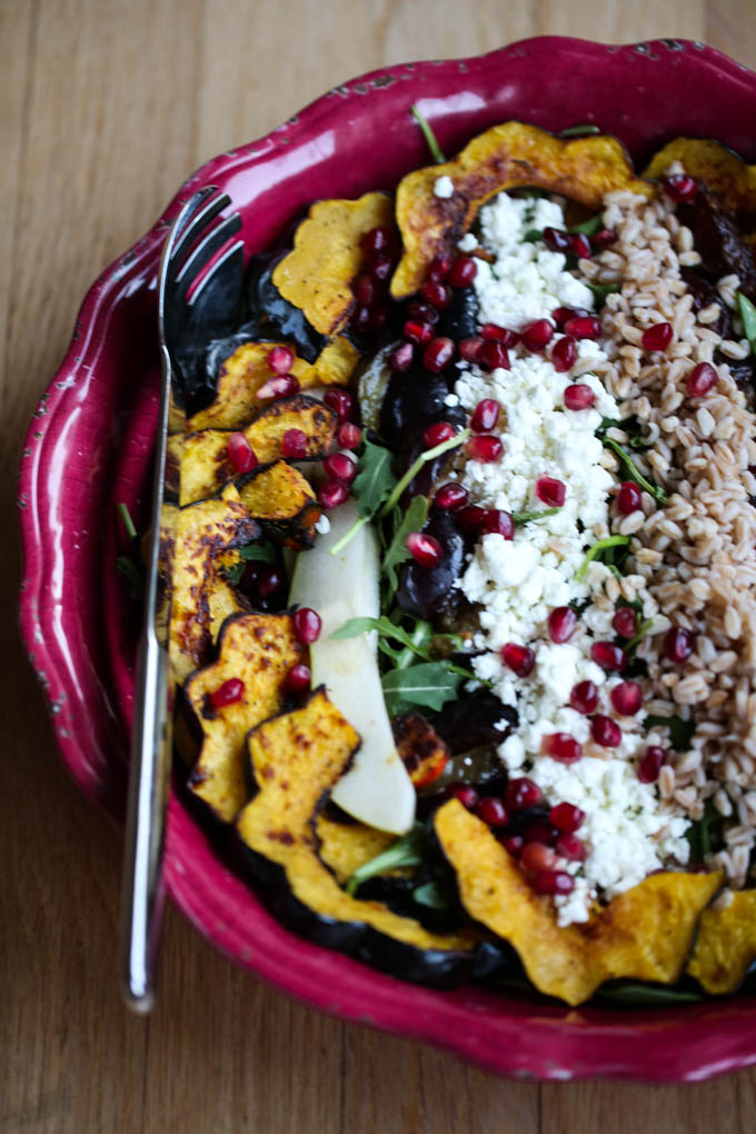 Autumn Bounty Salad filled with Roasted Acorn Squash, Italian Plums, Gala Apples, Dates, Farro, Spinach,,Arugula, Goat Cheese, & Pomegranate Arils