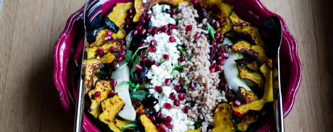 Autumn Bounty Salad filled with Roasted Acorn Squash, Italian Plums, Gala Apples, Dates, Farro, Spinach,,Arugula, Goat Cheese, & Pomegranate Arils