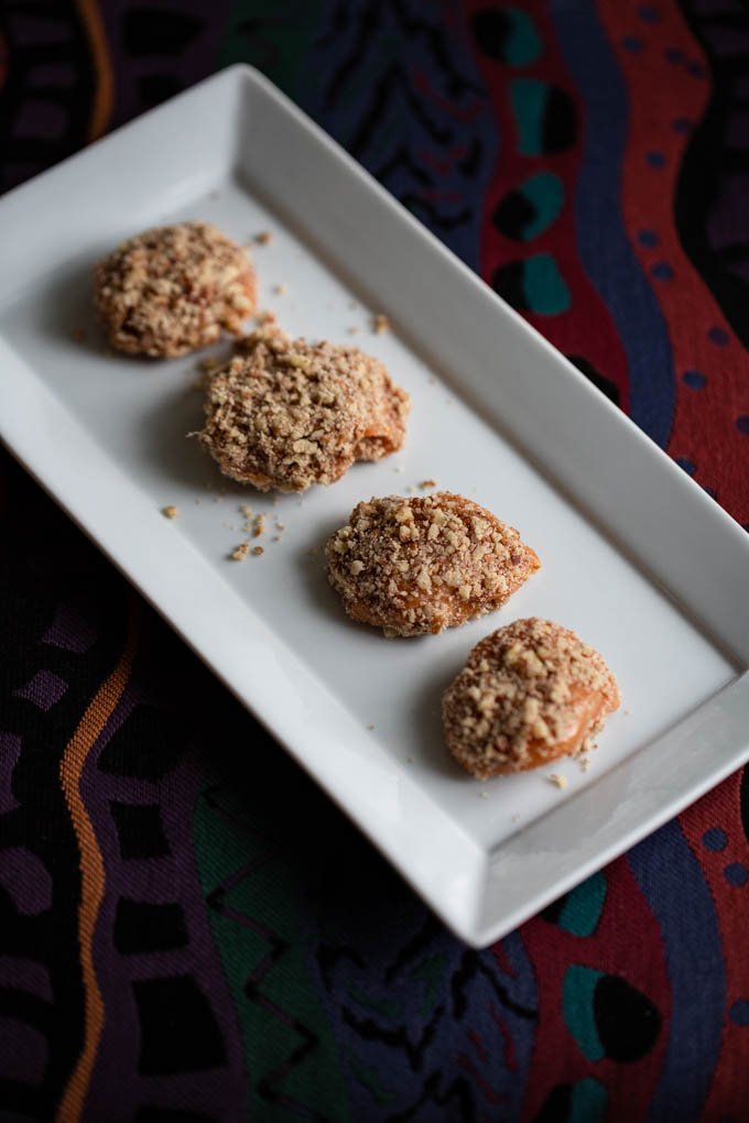 Apricot Delight is a dried apricot coated dipped in caramel and rolled in chopped pecans