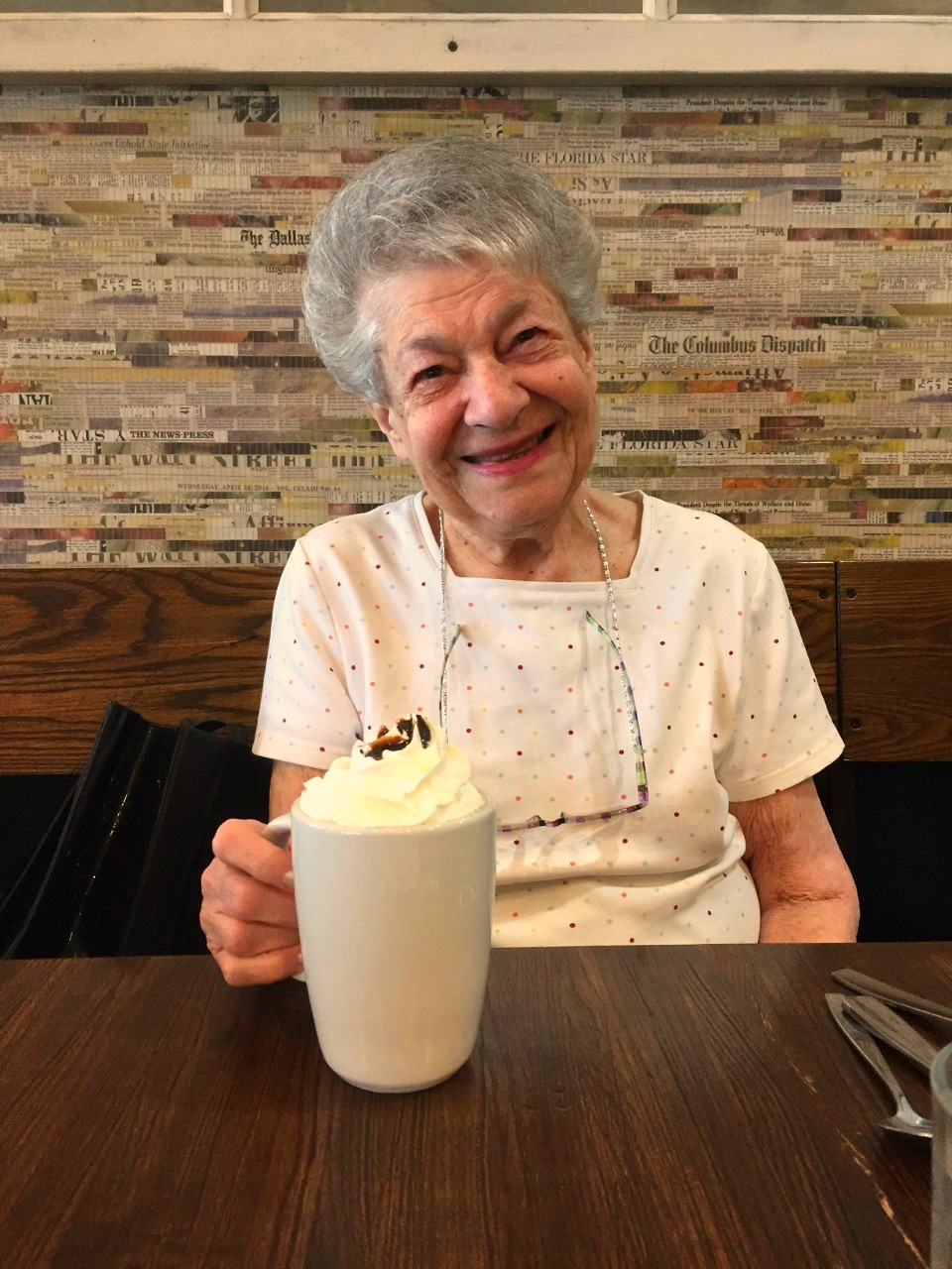 My mom having a mug of hot cocoa in 2018