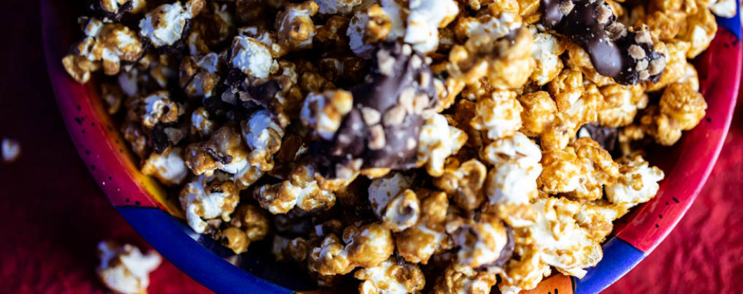 Caramelt Crunch Popcorn - popcorn drenched in a caramel coating drizzled with dark chocolate and crumbled toffee bits