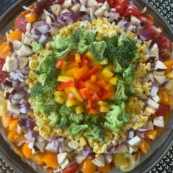 Rainbow Pizza with a sweet potato crust, bell peppers, corn,onions, butternut squash, eggplant, and broccoli