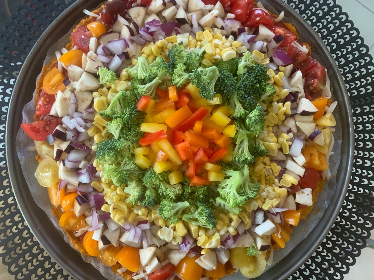Rainbow Pizza with a sweet potato crust, bell peppers, corn, butternut squash, eggplant, and broccoli