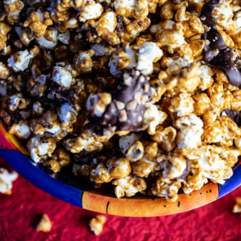 Caramelt Crunch Popcorn is caramel popcorn drizzled with dark chocolate and heath bar bits