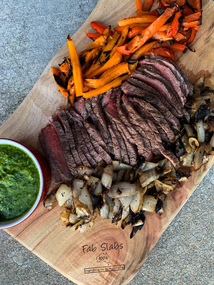Grilled Lime Marinated Boneless Sirloin with Peppers, Onions & Chimichurri