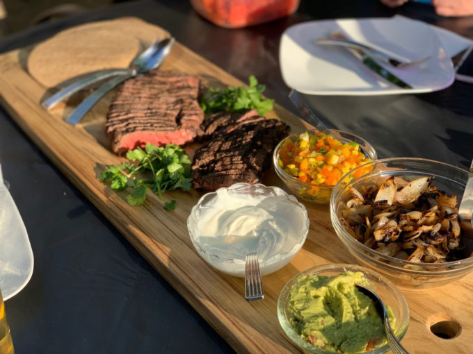 Grilled Beef Fajitas with Mango Salsa, lime yogurt, Grilled Balsamic Onions,& Guacamole