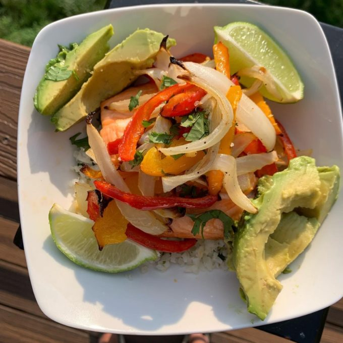 Salmon Bowl with cauliflower rice, roasted peppers & onions, and avocado